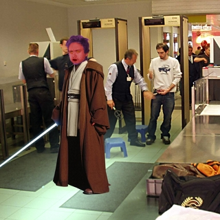 Jedi Knight Passing Through Airport Security